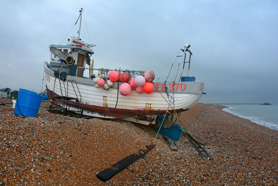 Coptic - FE 370 - at her shingle berth at Deal, Kent with a dropping tide and freezing north-westerly winds. Flash and 'neutral' on the picture setting.