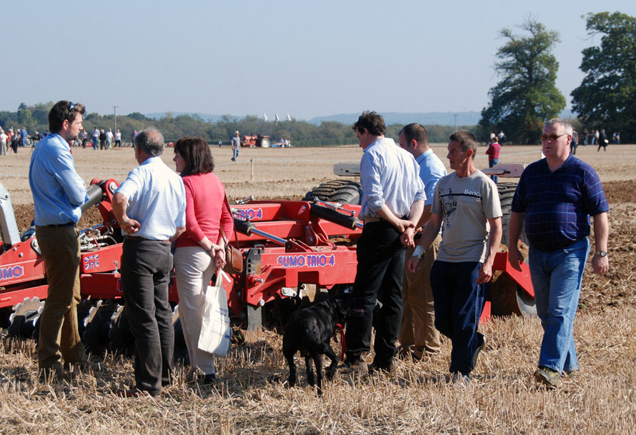 Making the pitch: salesman, punters and Sumo Trio 4 single pass cultivator while others look on at the East Kent Ploughing Match, 2011