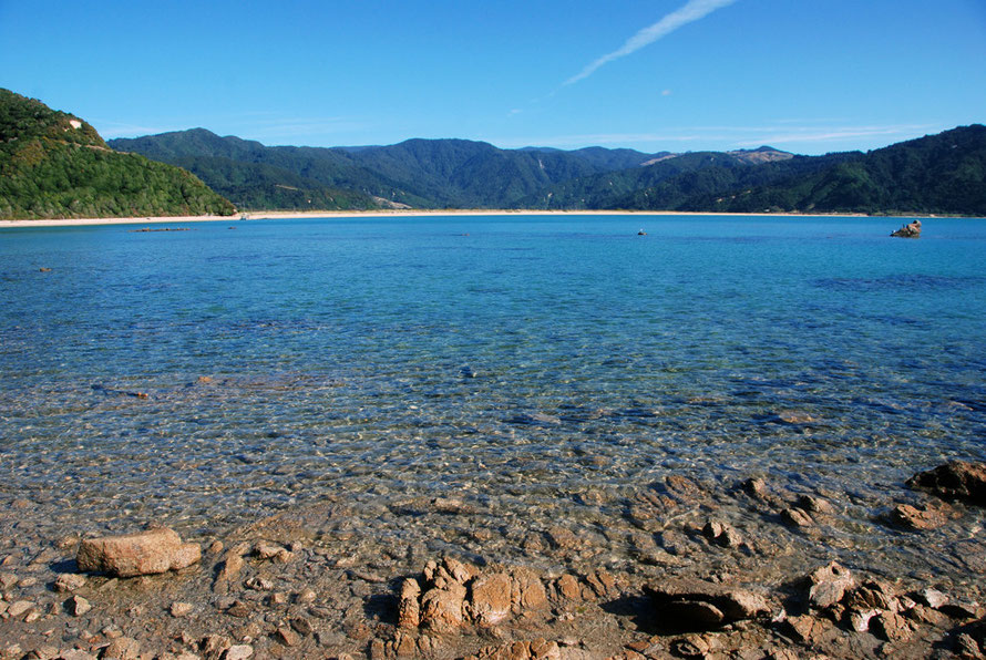 The brilliant waters of Wainui Bay on the Taupo Head walk, Golden Bay.