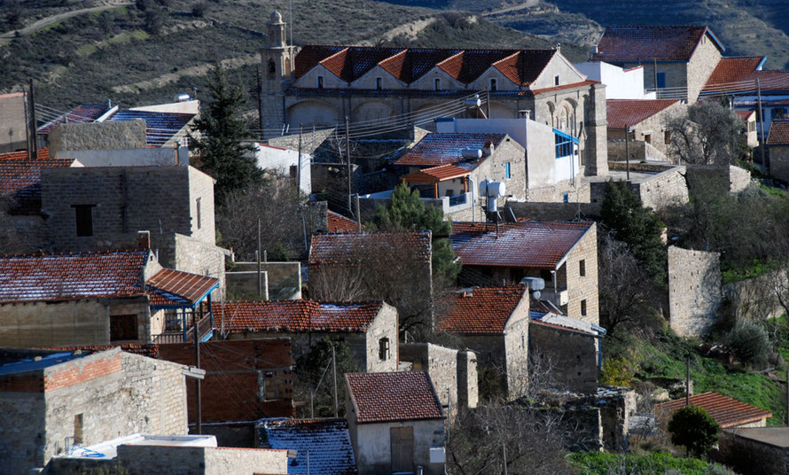 Church and houses at Vouni, last snow on the roofs, January 2013.