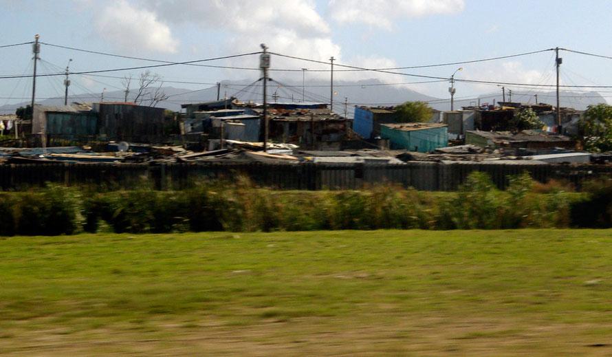 Informal settlement on the N2 heading towards Cape Town (c) Peg Murray Evans