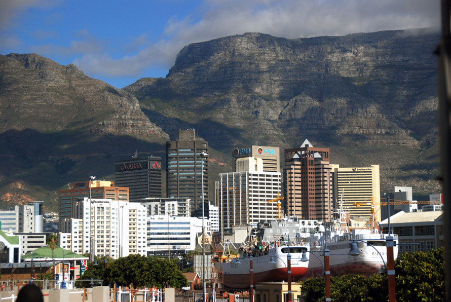 The bulk of Table Mountain looming above Cape Town's Central Business District