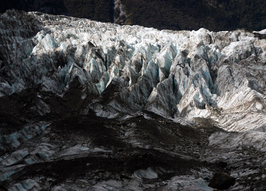 Crevasses worn down to arretes by melting and heavy rainfall at tht terminus of the Fox Glacier