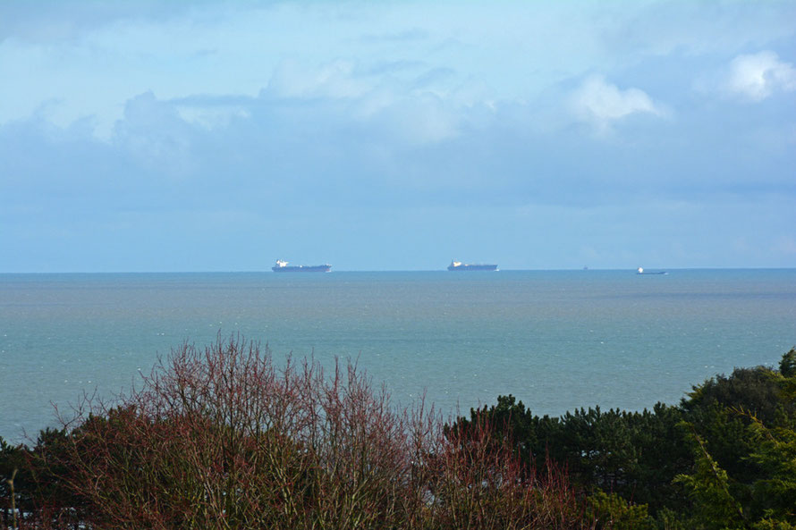 Then dazzling sun and these two huge LPG carriers out on the horizon.