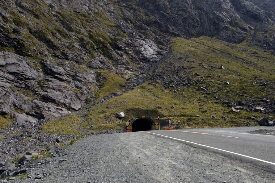 The eastern entrance to the Homer Tunnel. It is 512m (1,679ft) to the arete above the tunnel and a permanent snowfield sits to the left at 1800m under  Mts Moir and Belle (1,695m).
