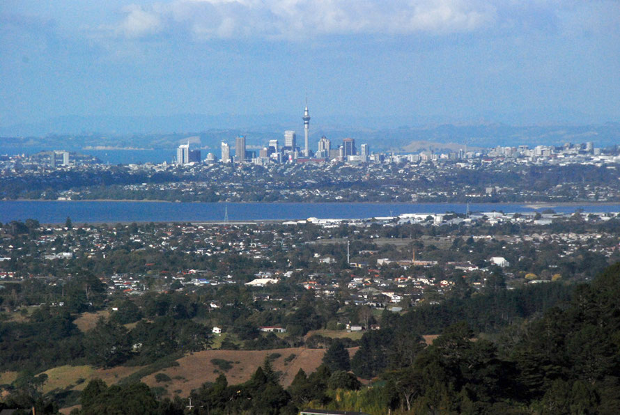 The Auckland CBD from the north west with the Hunua Ranges and the distanct Coromandel Peninsula in the background.