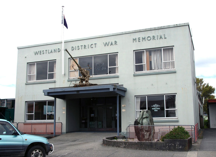 Westland District War Memorial in Hokitika with big ppiece of greenstone/pounamu in front