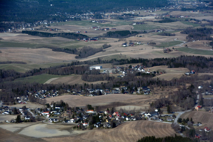 Villages and April farmland on the approach to Oslo Airport.