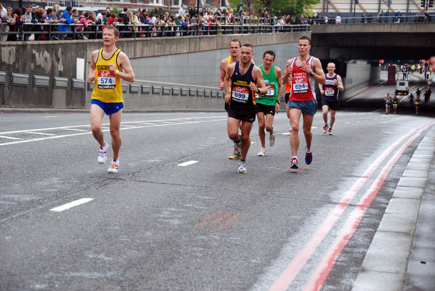 London Marathon 2010. The runners at mile 23 coming up the incline under Blackfriar's Bridge from Upper Thames Street.