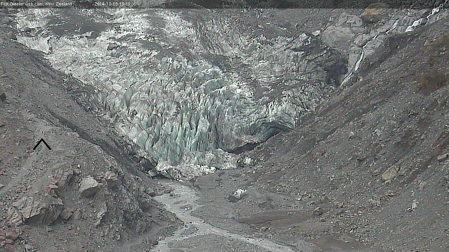 Fox Glacier from the web cam above on October 9th 2014. Arrow shows figure walking up the Observatory Path for scale.
