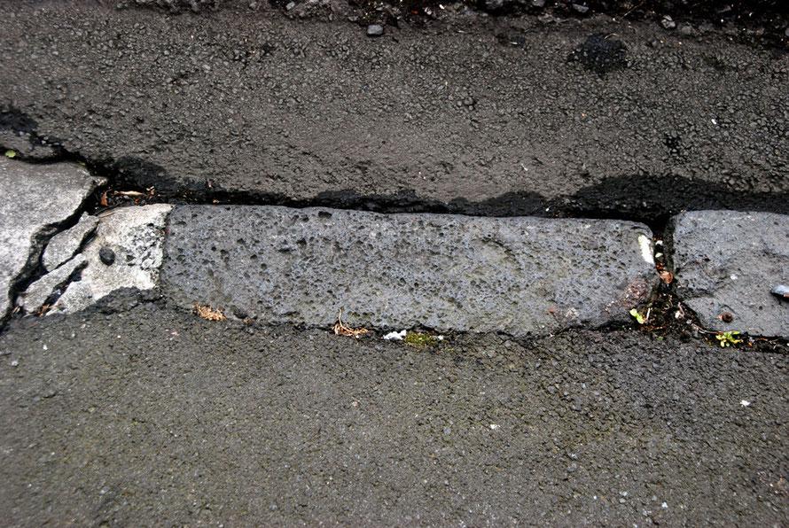 Old basalt lava kerb stone in Auckland's CBD near Chancery Street.