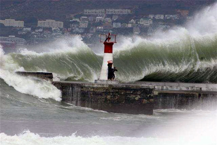 Massive waves at Kalk Bay in 2008 and intrepid photographers (copyright unknown)