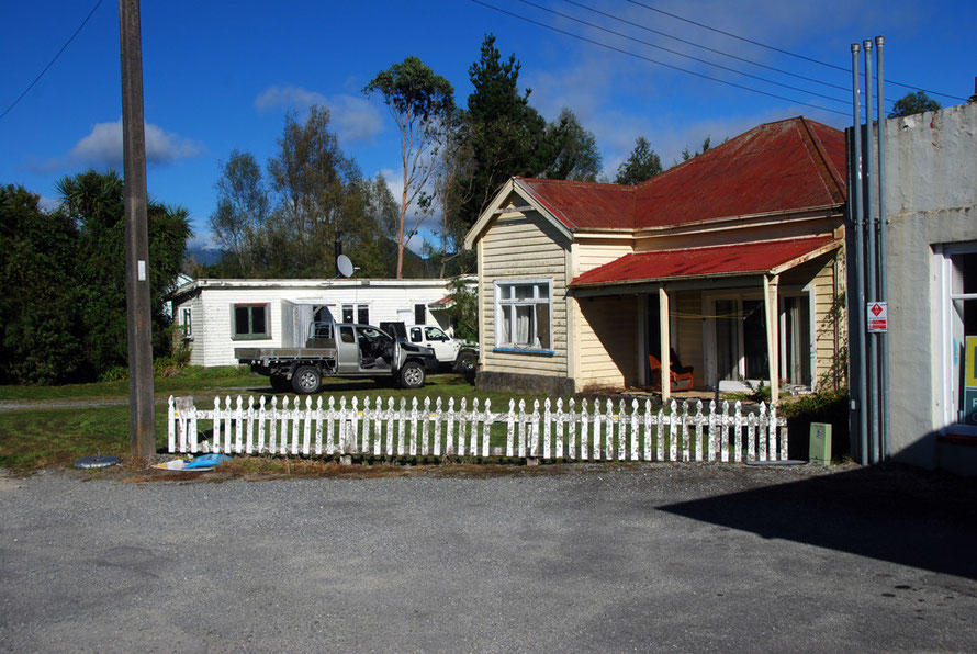 Red roof, picket fence and pick-ups, Whataroa.
