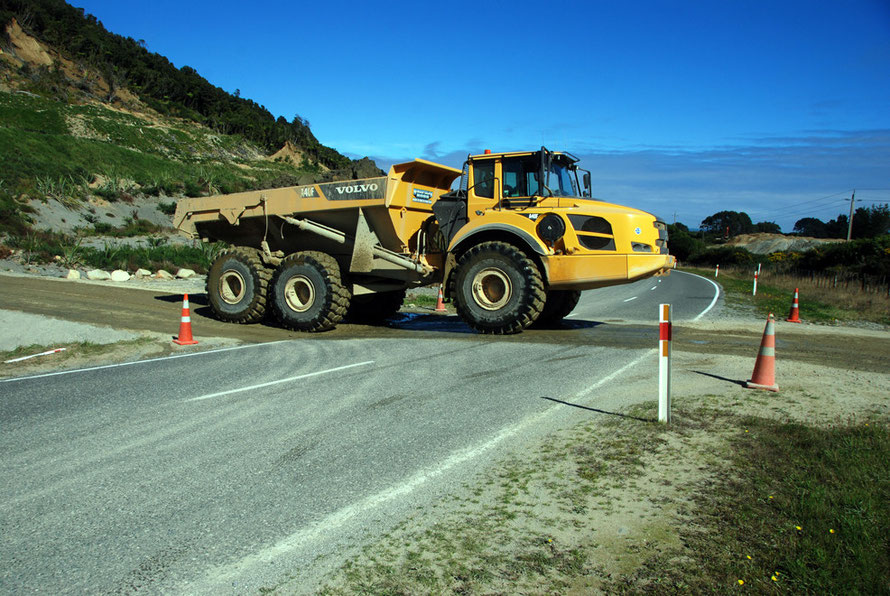 Modern small-scale gold mining across State Highway 6 between Whataroa and Ross in Westland.