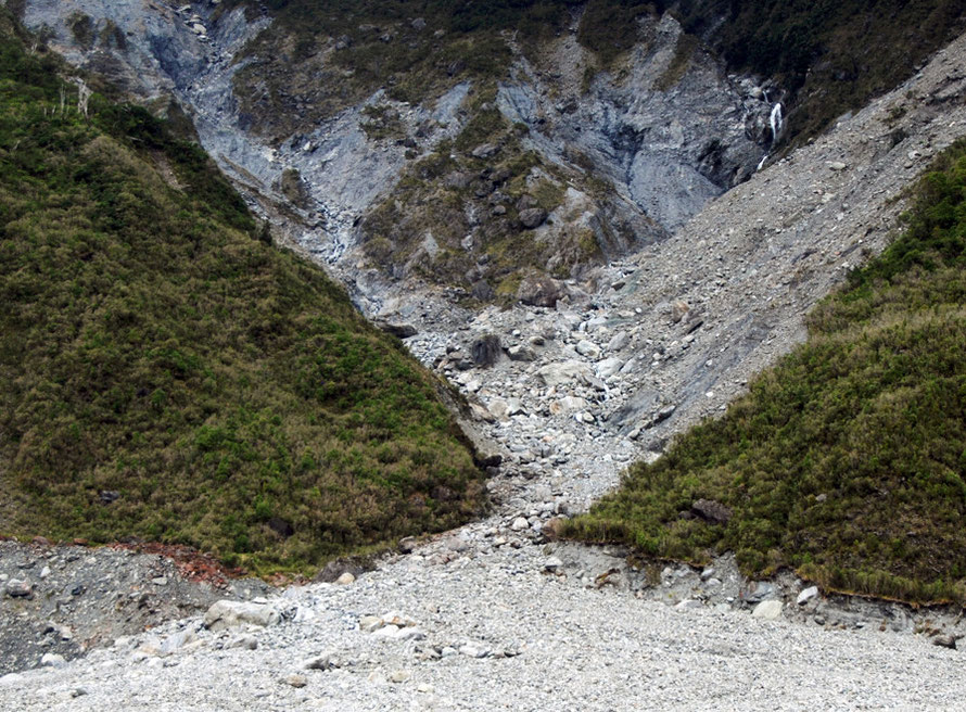 Erosion by ice is joined by erosion by mountain torrents that bring down huge amounts of debris, particularly when fed by snow meltwater in the spring and early summer