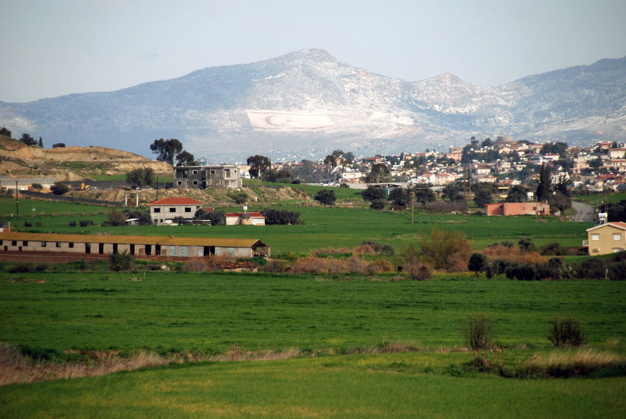Looking back towards Nicosia from near Tseri  and the ever present flags over the Green Line of the TRNC, picked out by the overnight snowfall