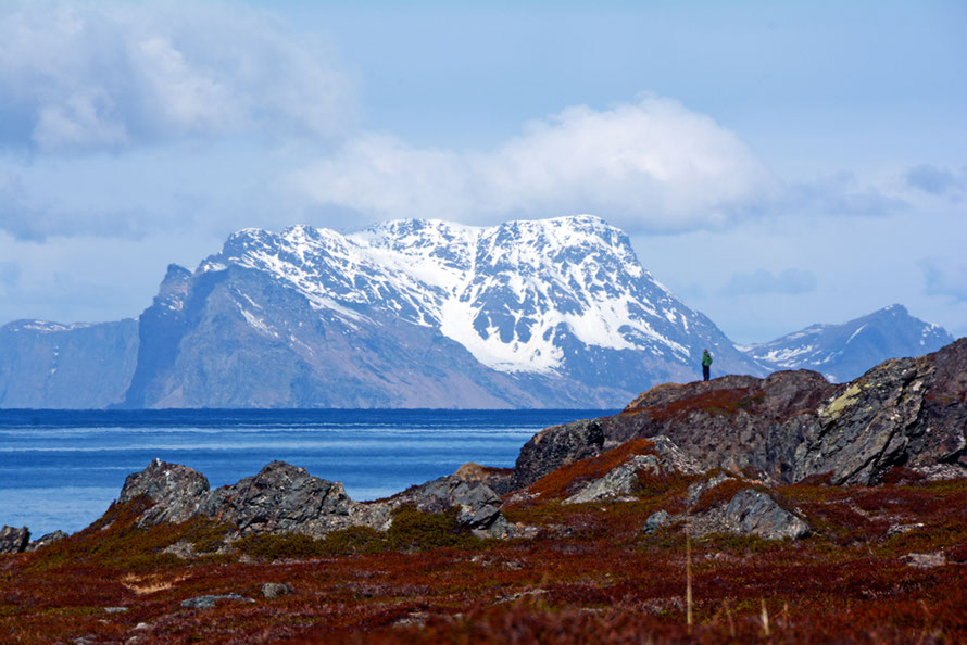 The impressive bulk (750m) of Nord-Fugløya island shimmering in the heat haze seen from the northern end of the Lyngen Peninsula. The island is uninhabited and formed of mica schist.