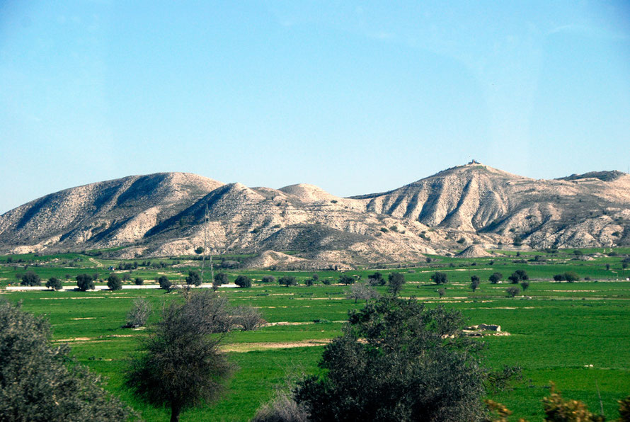 Cereal fields and the hills of the Louroujina Salient (February, 2011). Note Turkish Army Post on hilltop.