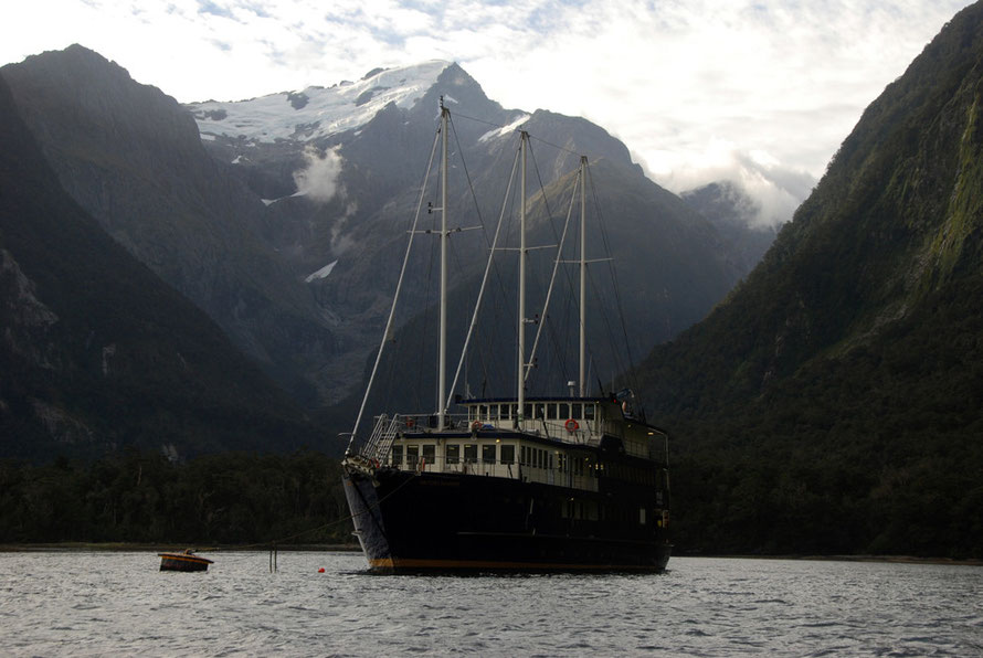 Our bed for the night, the Milford Mariner, moored in Harrison Cove with the imposing Mt Pembroke and cirque glacier towering above in Milford Sound.