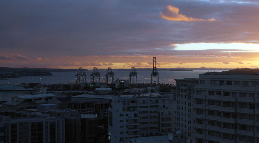 Day breaks ove the Hauraki Gulf and the Auckland Container Terminal.