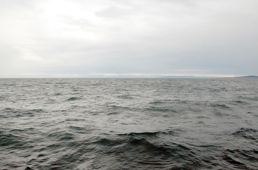 The vastness of the Pacific Ocean: view back to the New Zealand mainland from the Foveaux Strait between Bluff and Stewart Island