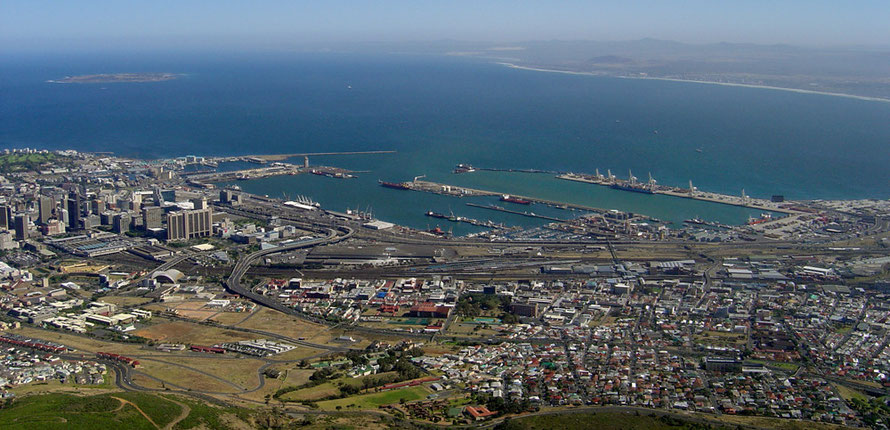 Cape Town Port from Devil's Peak with  Robben Island top right (Courtesy of Zaian@Wikimedia)