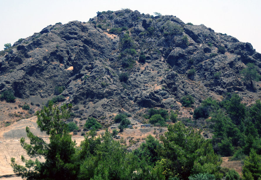 Dramatic dark basalt rocks near the Kalvassos copper mine in June 2012