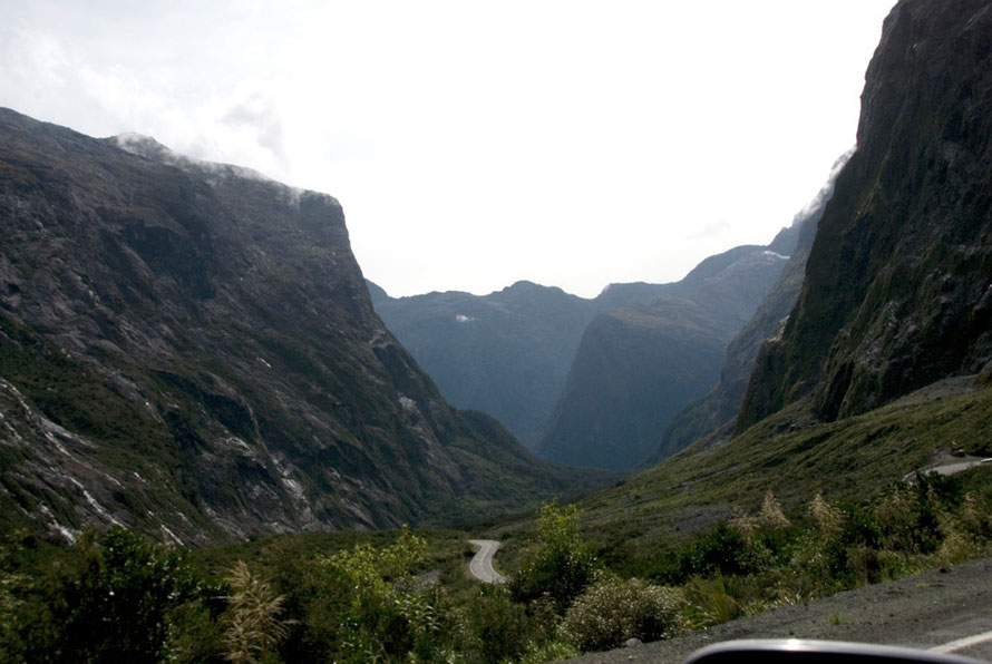 The view down the Cleddau Valley from the western exit of the Homer Tunnel with the road winding away below.