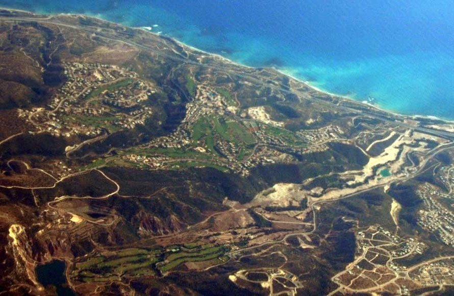 Aerial view of the irrigated greeness of Aphrodite Hills, near Petra tou Romiou