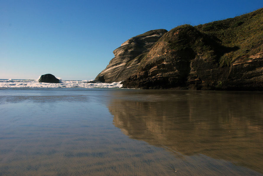 Wind erosion on the point of this giant rock formation on Wharariki Beach, Golden Bay.