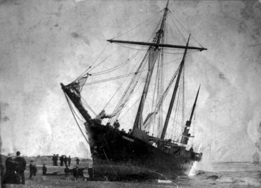 The steamer, Torgauten, stuck fast on the Hokitika bar in 1904. She was refloated tow months after having grounded through a fouled propeller (Hokitika Museum)