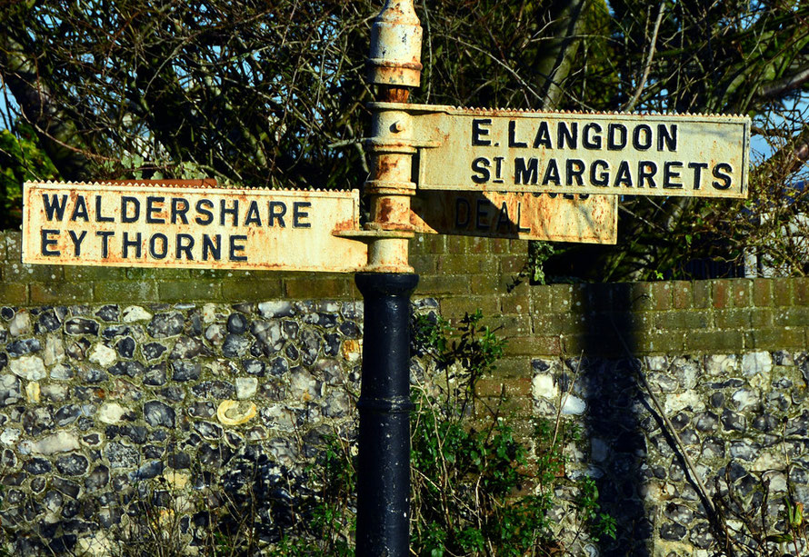 Road sign and flint wall in West Langdon in January sunshine, 2015.