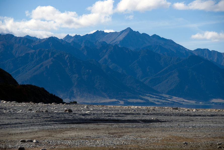 The ranges of the Southern Alps from the western shore of Lake Hawea. The McKerrow Ranges stand in front of the main spine of the Southern Alps rising to Mt Brewster at  2423m.