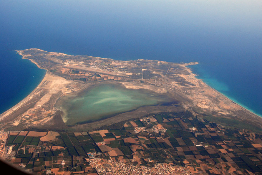 Aerial view of the Akrotiri Peninsula with Lady's Mile, British base, Cape Gata, salt lake, Cape Zevgari, Episkopi Bay and village of Kolossi, June 2012.
