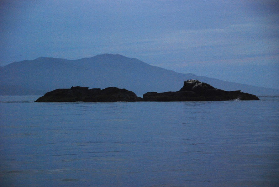 Fish Rock in different light in the Foveaux Strait.