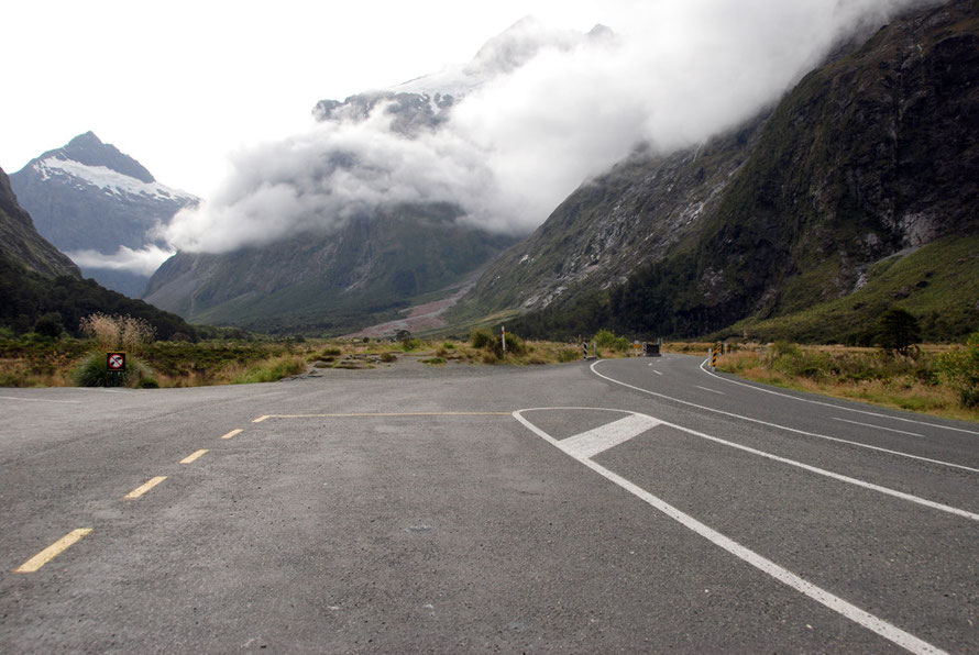 Down on the Hollyford valley floor looking north towards to Mt Christina (2,474m in clouds) and Mt Crosscut (2,263m).