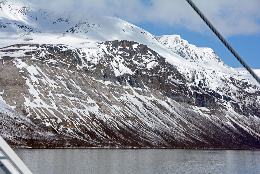 The massive truncated spur of Stortuva mountain (1100m) on the western side of the Ullsfjorden opposite the Lyngen Peninsula. The spur-end is in places over 500m high and has been carved out by a succession of glaciers of immense strength.