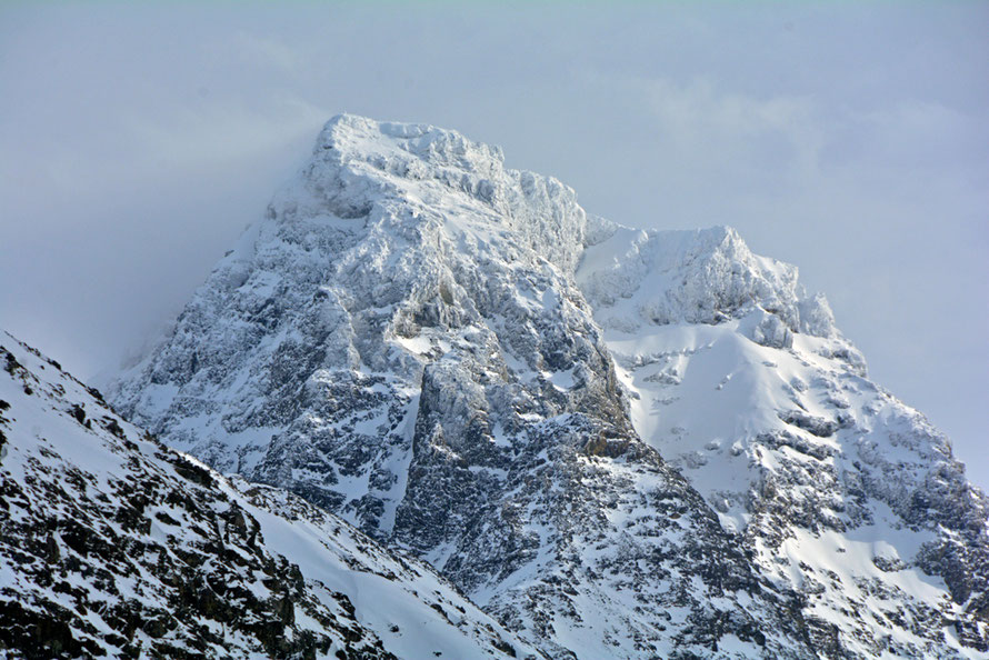 The snow and ice-bound peak of Forholtfjellet (1467m) in the southern half of the Lyngen Alps from Jøvik.