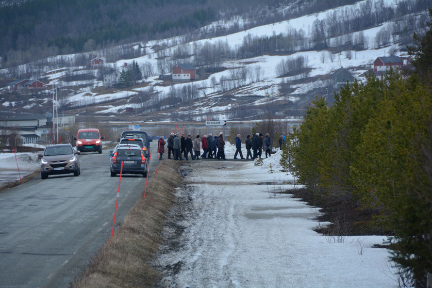 A funeral cortege nears the graveyard at Lakselvbukt on the road to Jøvik in April 2015.