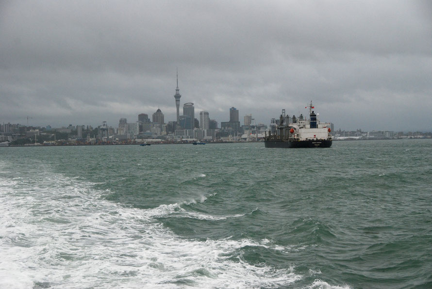 Fully laden bulk carrier 'Genco Pioneer' making for the Auckland port facilities under stormy skies after the passage of Cyclone Lusi the day before.