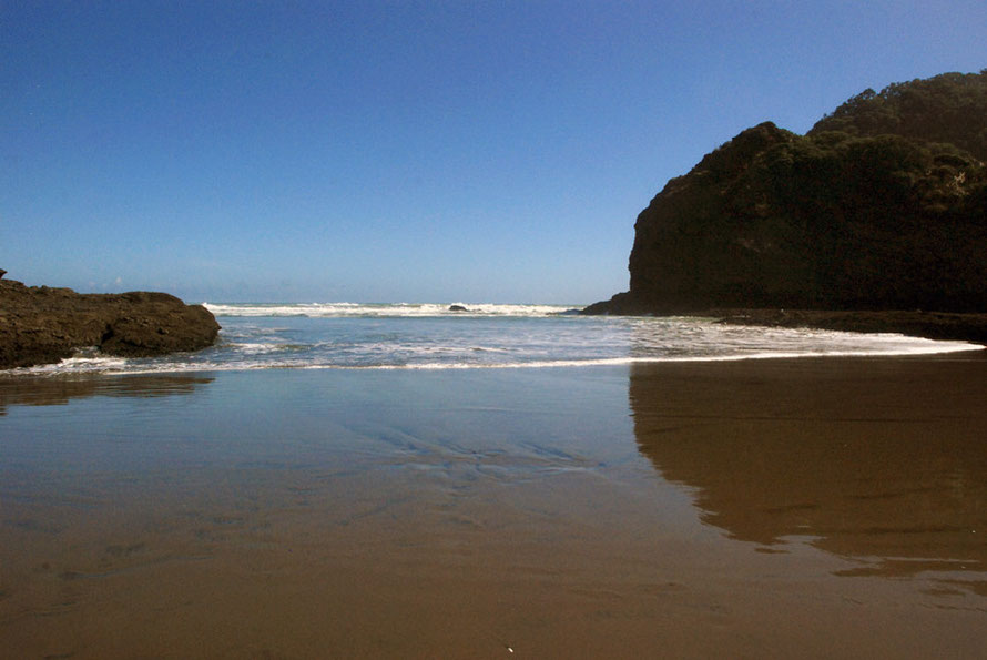 Pounding surf and reflections at Te Henga (Bethells Beach).