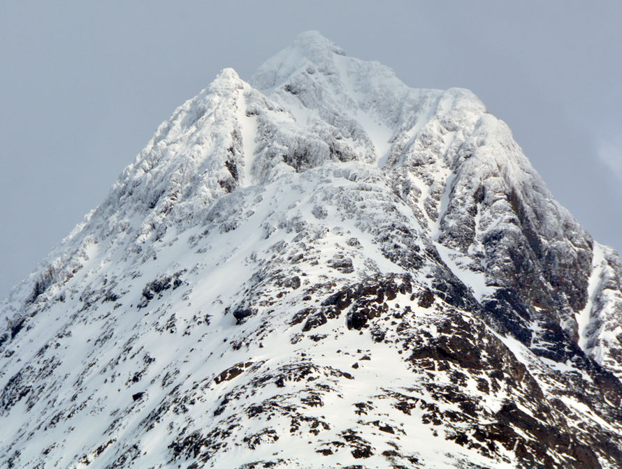 The frozen gabbro peak of Tytebaertinden (1177m) in the Lyngen Alps in mid April 2015.