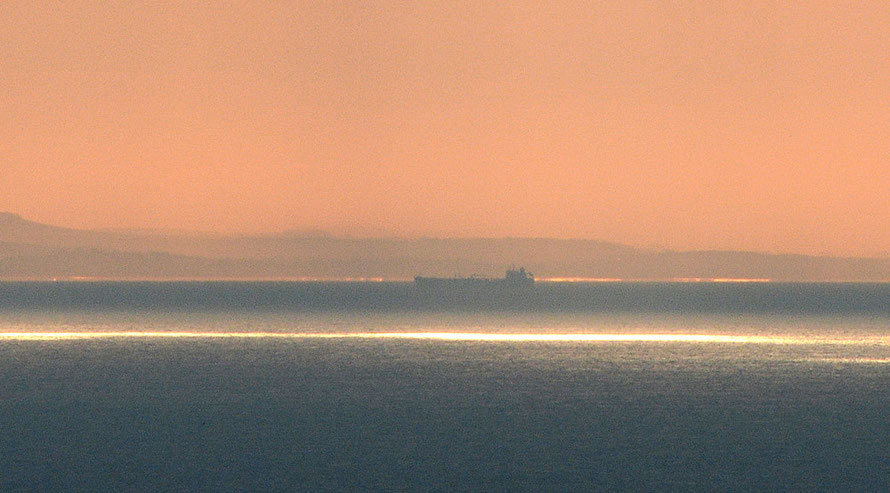 A crop from the shot above. F18, 1/320, ISO 400. That's a ship on the distant uplane of the Strait and France behind.