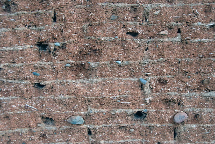 Detail of mud brick wall showing straw and stones in the layers of mortared brickwork, Peristerona.