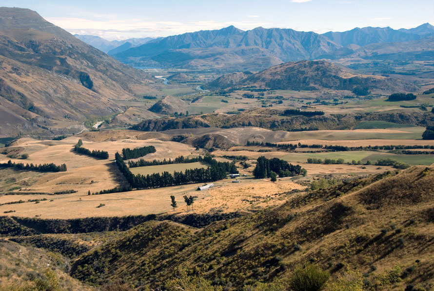 Another view looking towards Queenstown from the Crown Range with Vanguard Peak and the bends of the Kawarau River, which joins the Clutha/Mata Au at Cromwell.