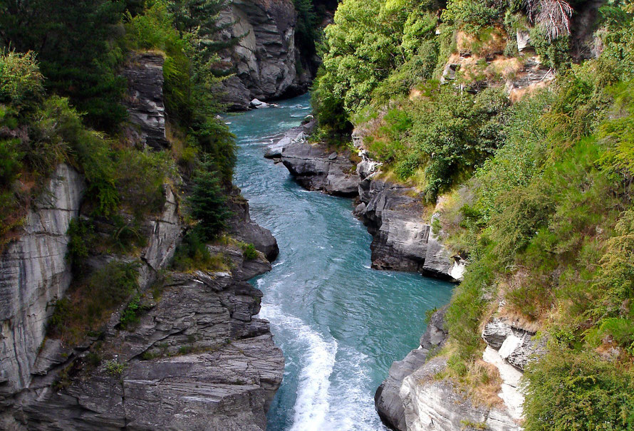 The Shotover River is the source of much of the sediment carried into the Clutha/Mata-Au. There is no lake to filter out the sediment as it flows into the Kawarau east of Queenstown (Courtesy Alex Proimos WikiCommons)