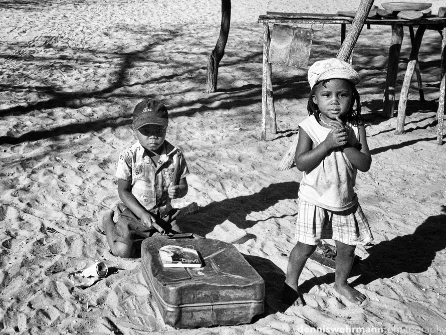 brother and sister, he plays the drums and she dances in front of their little hut for some coins or food in the captive strip, namibia. poverty in the boondocks is still a heavy burden...17mm; f7.1; 1/7400 sec.; iso 200