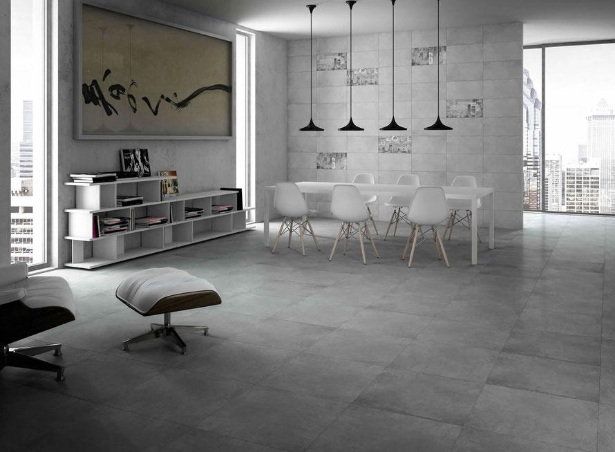 Piastrelle in gres effetto cemento adatte per la posa a rivestimento e a pavimento. L'inserto graffiti completa il look metropolitano ed essenziale, punto cardine della serie Cement.