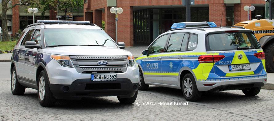 Amerikanische Militärpolizei und VW Touran der bay. Polizei.