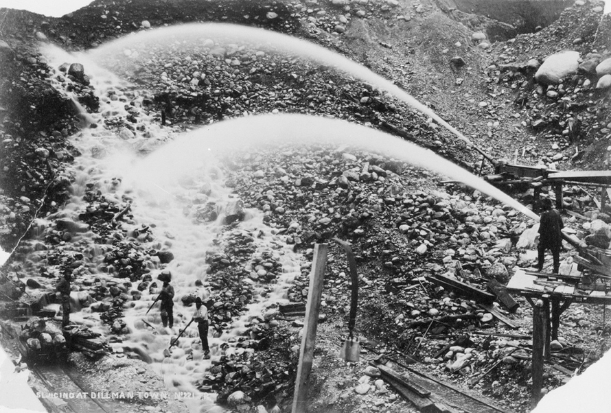 Hydraulic sluicing at Dillmanstown 15km east of Hokitika. It was dirty, wet and dangerous work (Alexander Turnbull Library, National Library of New Zealand)